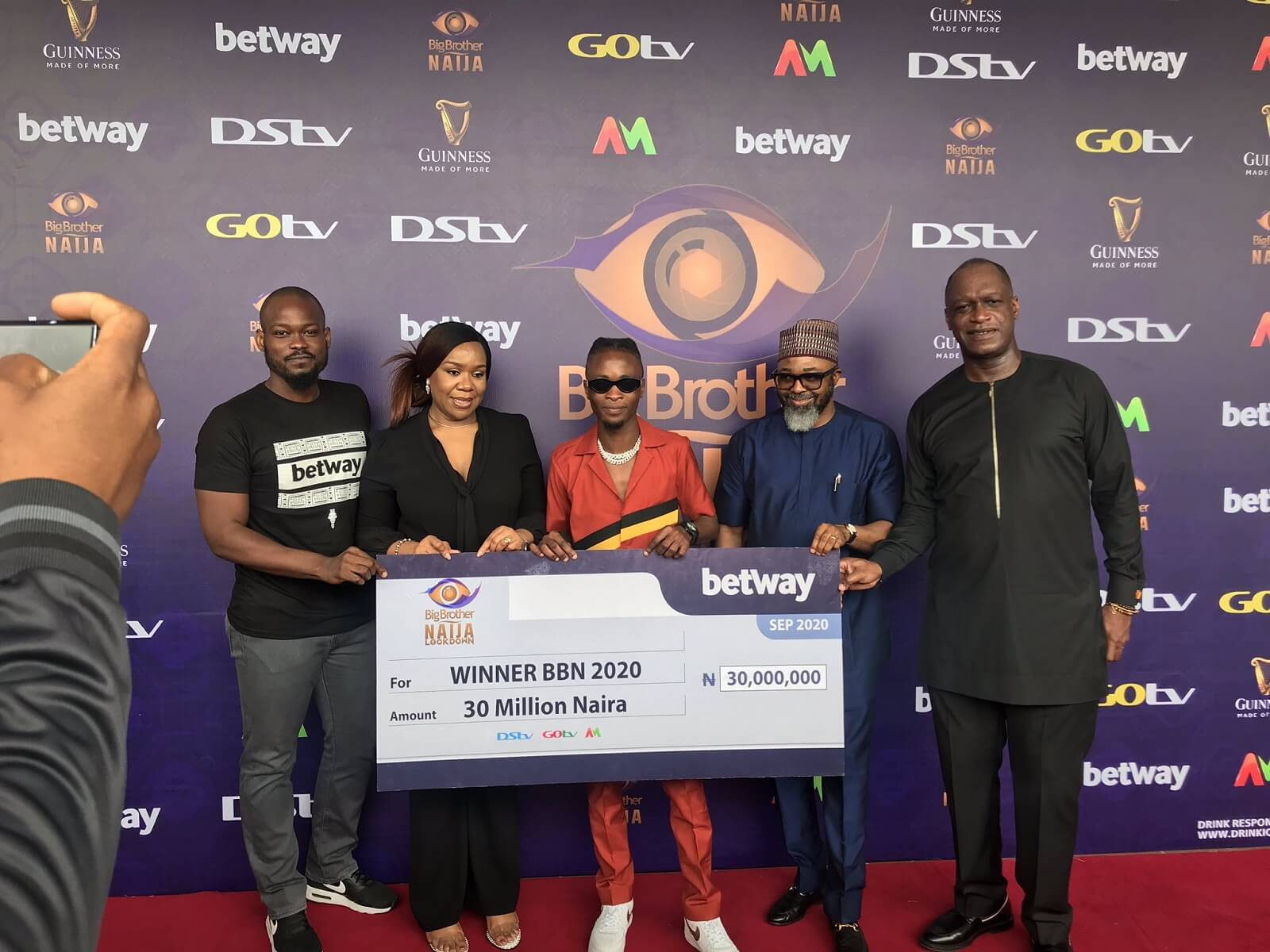BBNaija 2020 winner Laycon receives N30m cheque and SUV