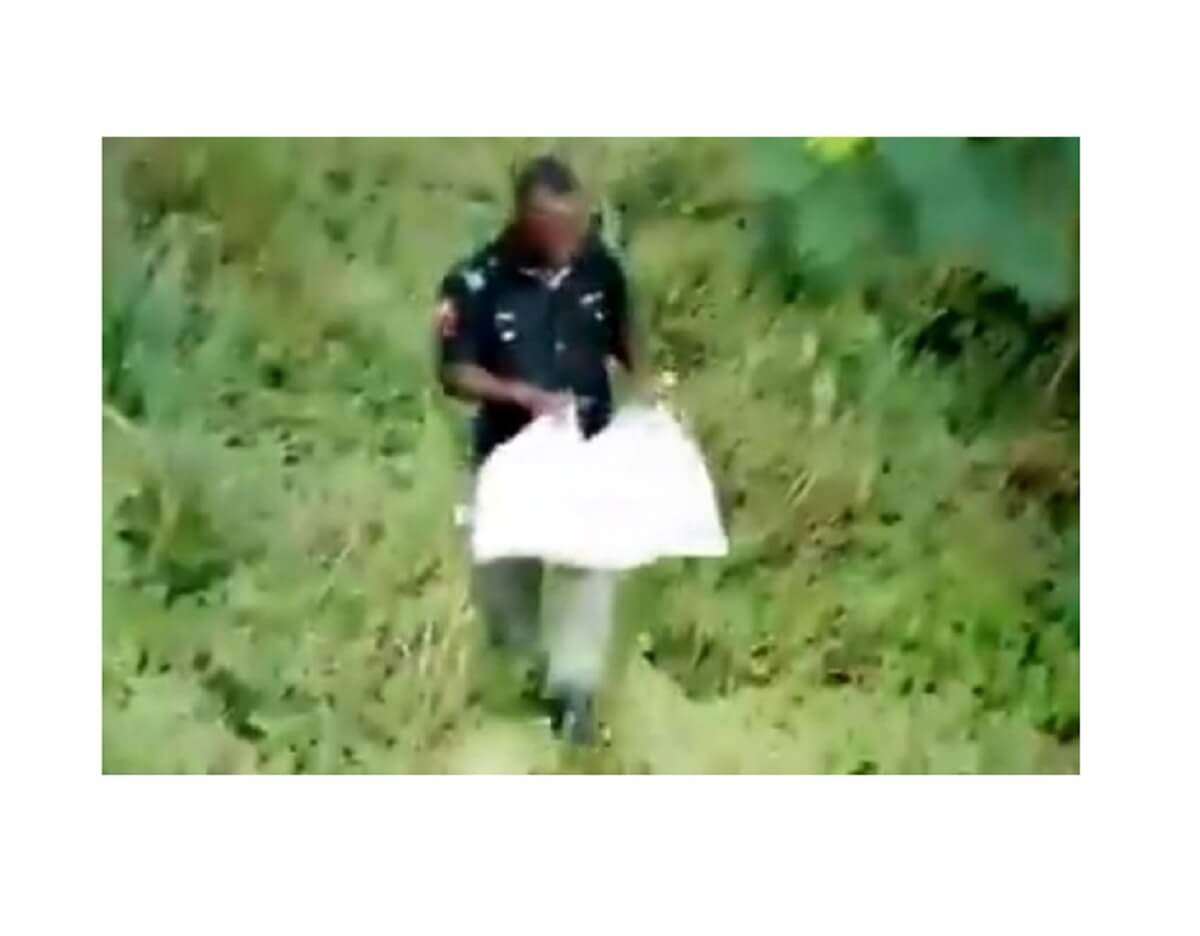 Policeman caught on video sneaking out COVID-19 palliatives from warehouse