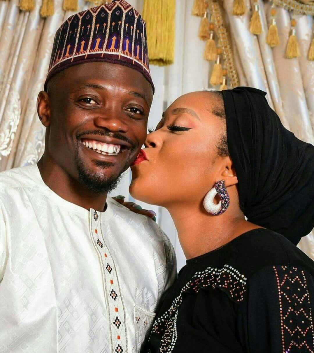 Muslims rebuke Ahmed Musa for posting a photo of his wife kissing his cheek