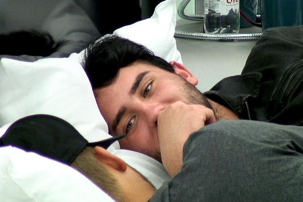 Video clip from Big Brother UK shows two gay housemates kissing and cuddling each other
